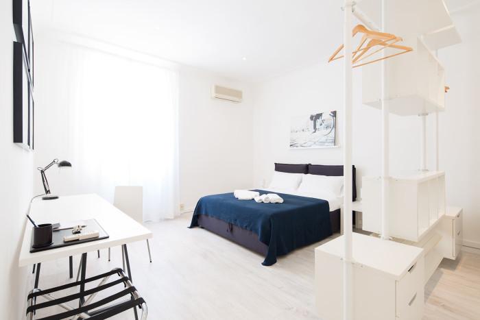 Fotografia d'interni: camera da letto della casa vacanze Home Inn Rome. copyright © _nf